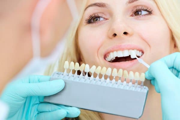 woman receiving cosmetic dentistry